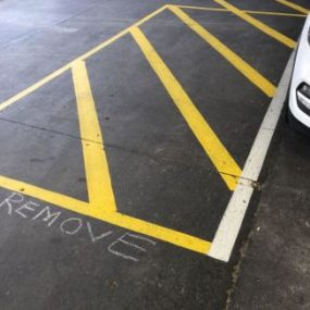 Paint line markings to be removed by retail surface preparation